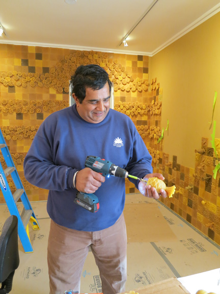 Raj drilling holes into the objects before we put them on the wall