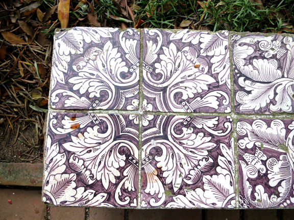 Dutch tiles with tin glaze on a bench near the citrus garden